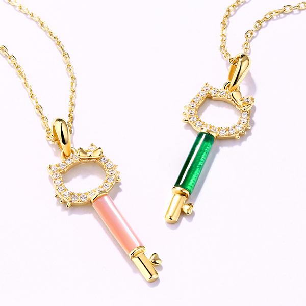 Cat key pendant with gemstone